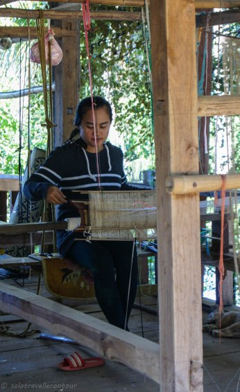Working hard at the weaving village