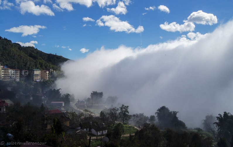 The fog moved like a solid wall over the valley