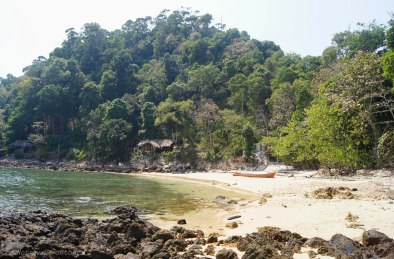 Remote Aow Ko Kyu beach overlooking some old bungalow