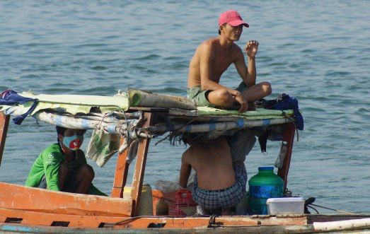 Fishermen enjoying the break after coming back from the sea