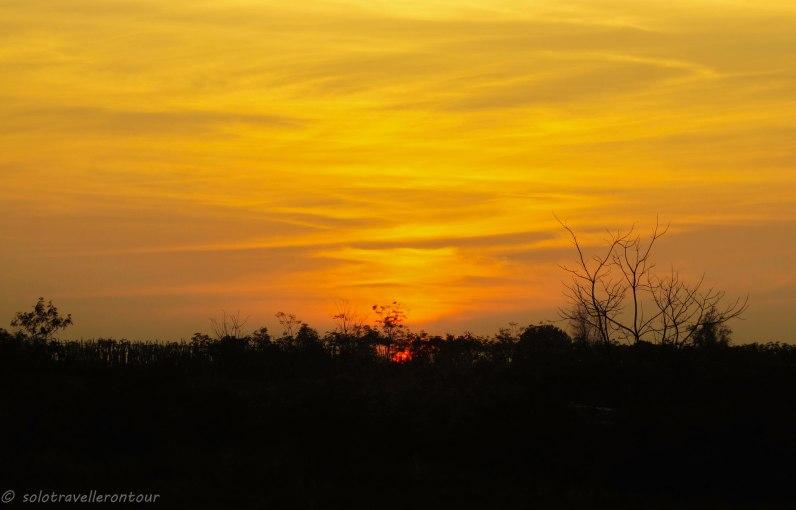 Sun set with Laos in tha far distance