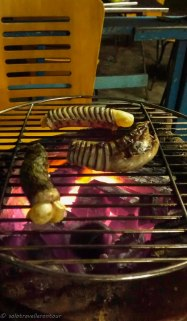 Grilled snake - the yellow bits at the ends were little eggs