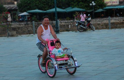 A father enjoying the cyclo ride more than his son