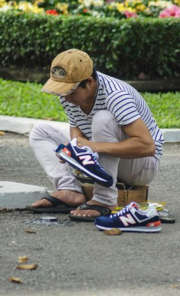 Cleaning shoes in a park