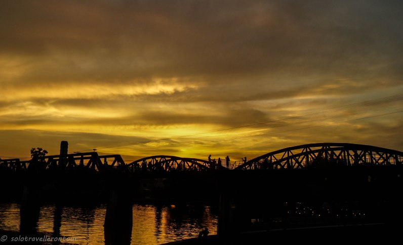 THe sun sets over the bridge