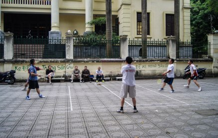 Locals utilising the badminton places on the pavement