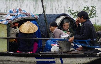 Family having breakfast on their boat
