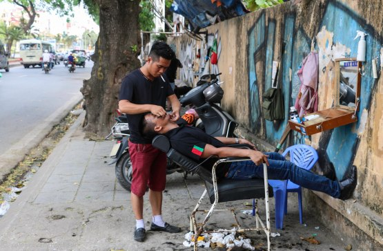 A barber working on the street