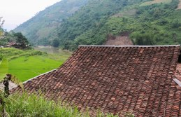 Colourful red tiles offer a great contrast to the green fields