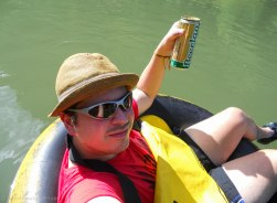 Enjoying the tubing with a cold beer