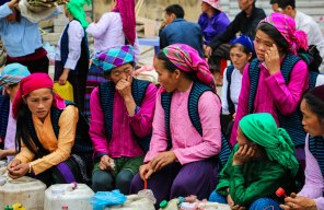 These women in the colourful outift tried to sell corn wine