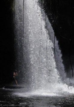 Paddling underneath the fall