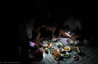 Dinner by torch-light
