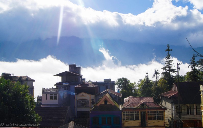 Colourful colonial buildings and mountains in the background - that is Sapa